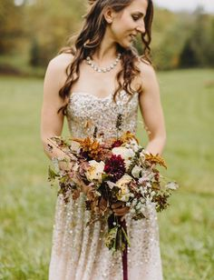 Sparkly blush BHLDN wedding dress with an equally gorgeous fall bouquet