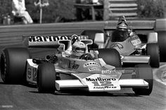 Jochen Mass of Germany drives the McLaren M23 9/Ford Cosworth ahead of Emerson Fittipaldi of Brazil in the Fittipaldi FD04 1/Ford Cosworth during the Swedish Grand Prix at Scandinavian Raceway near Anderstorp, Sweden, on June 13, 1976.