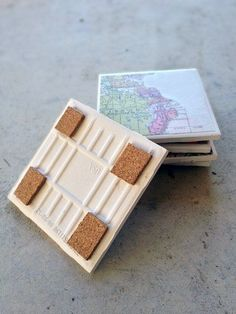 Old Map Coasters; great graduation gift for the girls. check out the link for more ideas: http://www.buzzfeed.com/elizabethlilly/17-drink-coaster-diys-made-with-plain-white-tile-o2yk