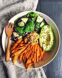 Spicy Sweet Potato Fry And Spinach Salad Hummus Bowl via @feedfeed on https://thefeedfeed.com/delicious-desk-lunches/clemfoodie/spicy-sweet-potato-fry-and-spinach-salad-hummus-bowl