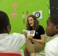 Allison Miller, a Notre Dame Mission volunteer, provides reading intervention at Julie Community Center in Baltimore, where she is a youth activities enrichment coordinator. The Notre Dame Mission Volunteers was founded to promote literacy
