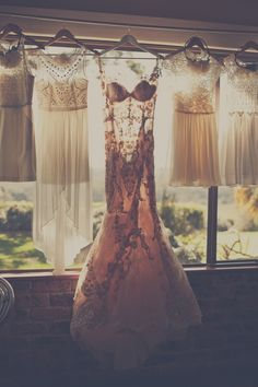 cute idea. Take a picture of the wedding dress and brides maid dresses together