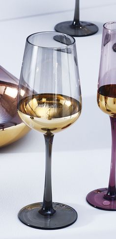 8e9dd91e8378 Sophisticated and opulent, the Boja Set of Four Gold Foil Wine Glasses will  lend a