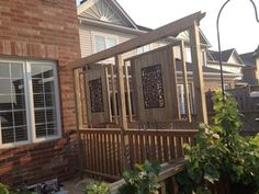 Iron and wood back yard privacy panels and wall art