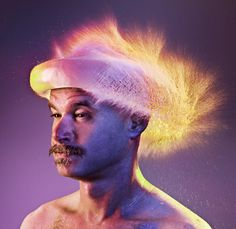 TIM TADDER - These fun photographs takes a group of bald men, and captures what happens when you hurl water balloons at their skulls. Using laser and sound triggers to initiate the shutter, the exact moments of water wig fulfillment are taken with an array of colours to accentuate the liquid and mimic hair colours.