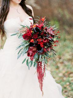 Wintery wedding bouquet: Photography: Natashia Nicole Photography Read More on SMP: http://www.stylemepretty.com/wisconsin-weddings/wausau-wisconsin/2016/01/20/northwoods-elegant-marsala-wedding-inspiration/