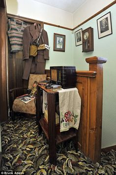 On patrol: An air raid warden's outfit hangs on the landing near a Bakelite radio ideal for tuning into Churchill's speeches