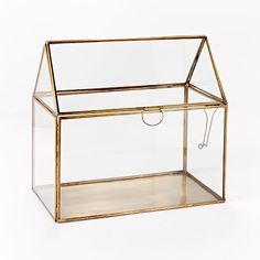 """House Terrarium:  Glass and metal. Hinged door. Not watertight. Imported. 10""""w x 6.25""""d x 11""""h."""