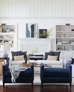 modern farmhouse living room design, modern farmhouse family room decor with white walls, modern sofa and neutral throw pillows and neutral area rug, neutral living room design with vertical paneling Coastal Living Rooms, Boho Living Room, Living Room Interior, Home And Living, Living Room Decor, Living Area, Cozy Living, White Living Rooms, Living Room Stools