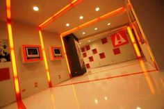 Fitness shop project  -  INTERIOR DESIGN - The shop is characterized by the use of withe and orange colours wich are the shop's brand colours.  The orange lines defines the space like some tracks of an ideal section of the white box.