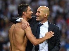 Cristiano Ronaldo and Zinedine Zidane, in his first season in management, celebrate after the Champions League final between Real Madrid and Atletico Madrid that went to extra-time and penalties