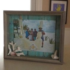 Shadow box with our picture from Passion Island off of Cozumel, Mexico and shells from the beach.