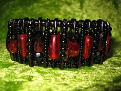Red and black safety pin bracelet. Look at my blog for more beaded jewelry by me: http://beadingwithsofie.blogspot.be/