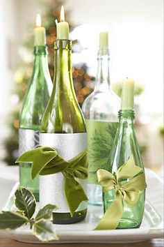 easy centerpiece using mismatched bottles as candleholders, wrapped with ribbon, on a tray — pretty, versatile