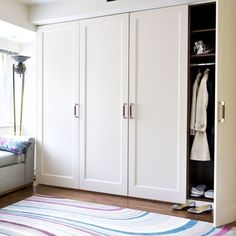 Built-in wardrobes. Floor to ceiling doors with hanging rod and shelf