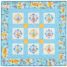 Gift Block baby quilt by Cleo Nolette