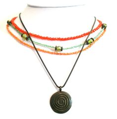 This Boho necklace will add to any outfit--looks good with jeans or a little black dress; 4 strands with a brass medallion (circle of life embossed