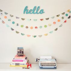 LOVE these circle and half-circle garlands. So simple and pretty. oh yeah, and ADORE the typewriter :) I miss mine..