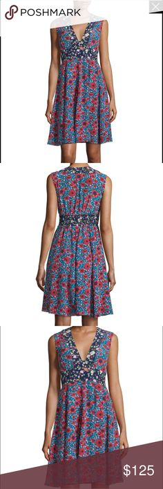 """Rebecca Taylor Sz 2 LINDSAY FLORAL V-NECK DRESS Contrasting floral prints define the squared v-front and waist of this carefree dress. Smocked waist at back ensures a comfortable fit.         Model is a size 2. Height 5'10. Hits above the knee. 38"""" inches from model high point shoulder. 100% silk. Lining: 100% polyester. Pocketing: 100% polyester. Dry clean only. Imported. Rebecca Taylor Dresses"""