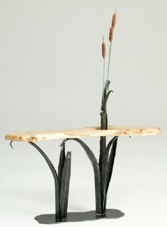 Forge Cattails with Organic Slab from Woodland Creek Furniture - $1595 - love how the slab mirrors the surface of water, with the stems of the cattails above, some leaves below