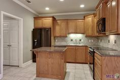 This excellent community offers a gated entry, guest parking and a community pool.  This condo is 3 bedrooms and is almost 1500 living area.  There are 2 full baths and a separate computer/office room.  The living room has a beautiful fireplace and wood floors.  The kitchen is very open and has granite tile counter-tops and an eat in island.  The master bath has a separate bathtub and shower with double vanity sink and a walk in closet.  There is an attached 2 car garage.  This condo is in…