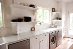 open shelving + marble + under counter appliances | brunson restoration and remodeling