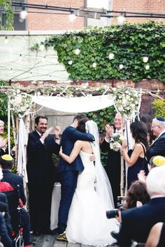 This chuppah is really pretty. I like the fabric over the couple and the flowers in the corners. Style Me Pretty | Gallery | Picture | #635800