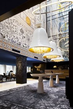 The Andaz Prinsengracht Boutique Hotel in Amsterdam in an incredibly well designed hotel.  The lobby has a  multi-level glass wall that highlights a cluster of crystal pendants floating like constellations.