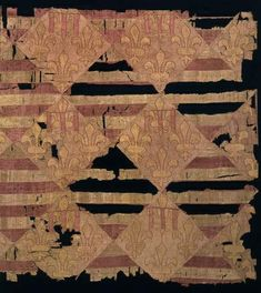14th Century royal quilt  This Hungarian quilt was found covered with mud at the bottom of a castle well lin Budapest, Hungary. The quilt is made of silk, in both patchwork and appliqué styles. It features blocks about 1 foot square in red and white.