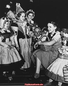Judy with the Munchkins