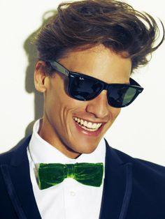 i would totally wear that bow tie - navy suit with green paisely lining, some kickin' stilletos, and maybe some green patterned suspenders to top it off.