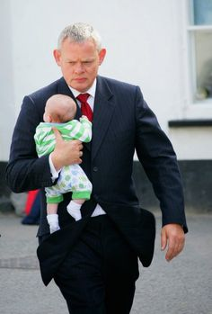 Doc Martin & James Henry...I love the way he carries the baby