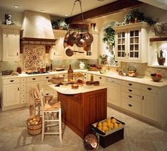 Love the pots above the island instead of the stove :)