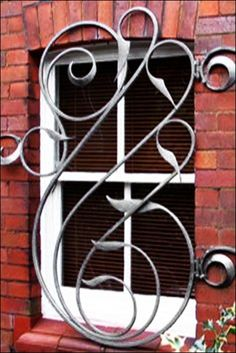 Wrought iron doors are indeed a style from the past. With creativity, you can make your house look more sophisticated with the wrought iron front doors. Wrought Iron Decor, Wrought Iron Gates, Iron Windows, Iron Doors, Burglar Bars, Window Bars, Window Grill Design, Iron Furniture, Iron Art
