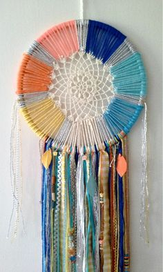 This is a colorful and attractive dream catcher made with different colored strings attached to the loops in the center. To make it even more beautiful, add different kinds and colors of cloths and feathers. Source by hoodfamank ideas art Dream Catcher Tutorial, Dream Catcher Craft, Doily Dream Catchers, Paper Feathers, Diy And Crafts, Arts And Crafts, Crochet Dreamcatcher, Crochet Doilies, Diy Crochet
