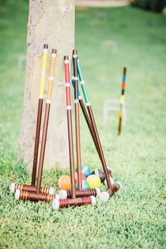 Multi-colored wooden croquet set.