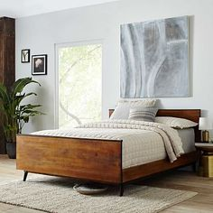 Taking inspiration from '50s and '60s furniture design, our modern, yet rustic, Lars Mid-Century Bed's silhouette is simple, yet sophisticated.