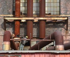 Work began on three smoke stacks being removed at the Ansonia Copper & Brass facility in Ansonia on 10/27/2015.  Photo by Arnold Gold/New Haven Register   agold@newhavenregister.com