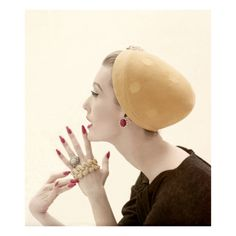 Vogue - September 1955 by Richard Rutledge. Profile of model Mary Jane Russell's head wearing hat of lemon velour by Adolfo of Emme, holding gold and diamond jewels from David Webb.