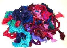 This listing is for 4 oz of silk fabric remnants. These are by products of the sari industry--so the textures and colors are varied, and some have metal threads. The pieces are 1-3 inches wide and a yard or so long, and most have raw edges on both sides. The raw edges make it easy to use
