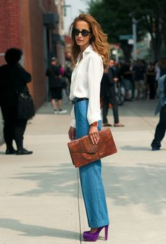 White blouse, denim trousers, and a pop of color.