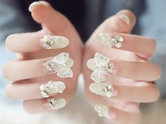 Pre-glued artificial nails with rhinestones and bows. http://www.onlinewholesales.biz/product-detail/venetian-pearlrhinestonebow-pre-decorated-artificial-pre-glued-nails/