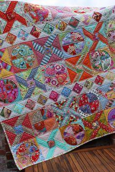 Fun, happy quilt from Ballaratpatchwork.com.au. Unusual block design -- Y-seams?