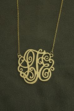 """1 1/8"""" diameter,14k yellow gold monogram on 16"""" anchor cable chain .. $295.00, via Etsy."""