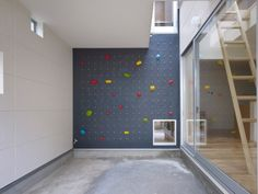 Why go to the climbing gym when you can just put a climbing wall in your home?