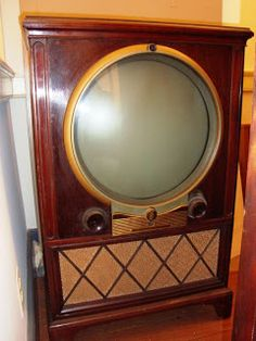 """Zenith black-and-white television set, The round viewing screen is 16 inches in diameter. The cabinet (or """"chassis"""") is mahogany veneer. Vintage Tv, Vintage Antiques, Vintage Items, Vintage Black, Vintage Television, Television Set, Illuminati, Tvs, Radios"""