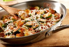 Sautéed zucchini and onion are simmered briefly in tomato sauce and topped with melted cheese to make a delicious side dish that's ready in 30 minutes.