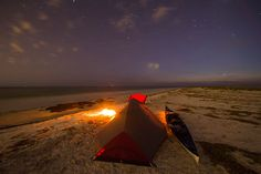 Camp on the beach on Anclote Key, Fort De Soto or Shell Key Preserve.