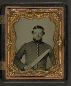 [Unidentified soldier in Confederate uniform with Bowie knife] (LOC)