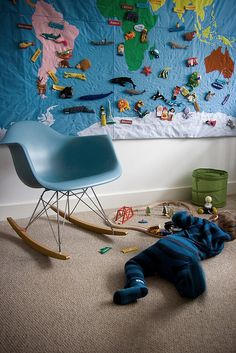 This play space features a wall tapestry that doubles as a teaching toy. Neat!